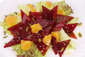 Beet salad with orange and sesame. — Stock Photo