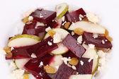 Beet salad with feta cheese and raisins. — Stock Photo