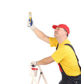 Worker on ladder with brush. — Foto de Stock