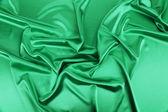 Shiny green silk background. — Photo