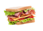 Appetizing sandwich with ham and cheese. — Stock Photo