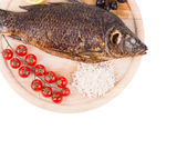 Grilled carp on platter with rice and tomatoes. — Stock Photo