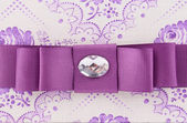Violet bow with gem. — Stock Photo