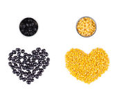 Two hearts in form olives and corn. — Stock Photo