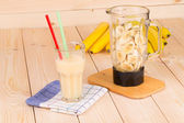 Banana juice and blender. — Photo