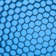 Honeycomb grid against blue background — Stock Photo