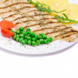 Grilled salmon steak served of peas and tomatoes — Stock Photo