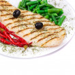Grilled salmon steak served of peas and red pepper — Stock Photo