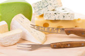 Cheese and knife on wood platter. — Stock Photo