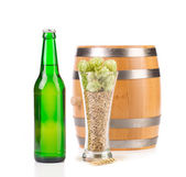 Beer bottle and mug — Stock Photo