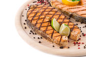 Steak on wood platter. — Stock Photo