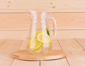 Lime and lemon in carafe — Stock Photo