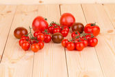 Tomatoes on the wooden desk — Stock Photo