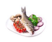 Grilled seabass on plate with mushrooms. — Stock Photo
