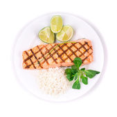 Grilled salmon filler with risotto. — Stock Photo