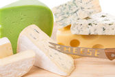 Cheese composition with knife — Stock Photo