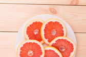 Freshly harvested grapefruit in a plate — Stock Photo
