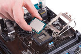 Black powerful motherboard with hand.  — Stock Photo