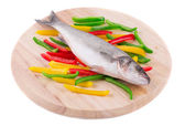 Seabass with vegetables. — Stock Photo
