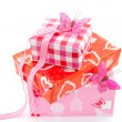 Boxes with gifts and pink butterflies — Stock Photo