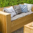 Stock Photo: Garden bench in backyard
