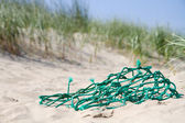 Fishing net in the dunes — Stock Photo