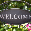 Welcome sign in the garden — Stock Photo