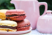 Macarons and teapot — Stock Photo