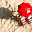 Stock Photo: Two miniature deck-chairs on the beach with umbrella