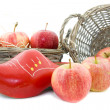 Red apples and wooden shoe — Stock Photo