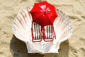 Miniature deck-chairs on the beach — Stock Photo