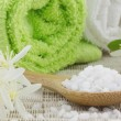 Close up of spoon filled with white bath salt — Stock Photo