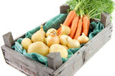 Auction crate with vegetables — Stock Photo