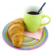 Cup of coffee and croissant on colorful plate — Stock Photo