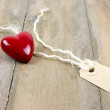 Plastic heart and label tag — Stock Photo
