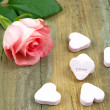 Stock Photo: Pnk rose and heart candies