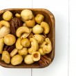 Wooden bowl filled with nuts — Stock Photo