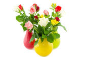 Three colorful vases filled with roses — Stock Photo