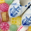 Old dutch traditional candy and miniature wooden shoes — Stock Photo