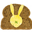 Slice of dark bread with fried egg in Easter Bunny form on it — Stock Photo #38289483
