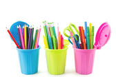 Three miniature dustbins with stationery — Stock Photo
