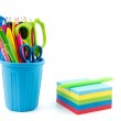 Multicolor memo pad and mini container filled with pens and penc — Stock Photo #38707465