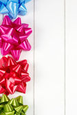 Four multicolor gift bows — Stock Photo