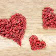 Stock Photo: Three goji berry hearts