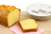 Part of butter cake, slice of cake and cake plates — Stock Photo