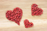 Three goji berry hearts — Stockfoto