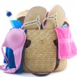 Stock Photo: Reed beach bag filled with bikini, slippers, water etc