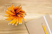 Top-view of several pencils and notebook — Foto Stock