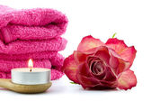 Tea light, towels and rose — Stock Photo