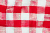 Red and white checkered table cloth — Stock Photo
